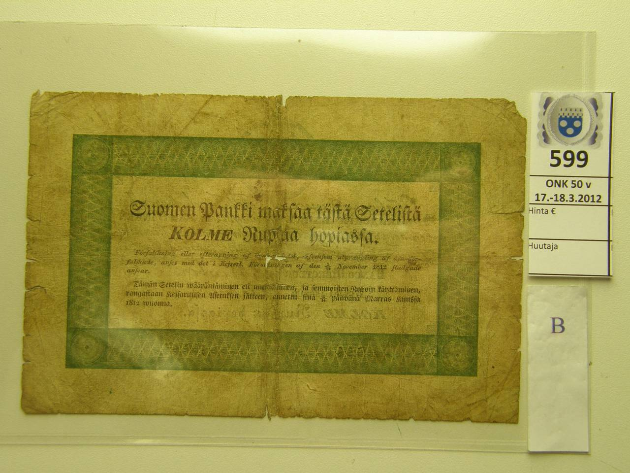 k-0599-b.jpg - Kohde 599 (kuva 2/2), lähtöhinta: 15000 € 3 ruplaa 1841 Pick#A29 SNY 51 11844 Winter-Hjelm, vas yläkulmapuutos, repä, reikiä, rosoreunat, hauras. Toinen tunnetuista! Russian administration, 3 rubles 1841, Pick#A29. Very rare, only two pieces known! Condition good-fair, a small piece missing from left upper corner, kunto: 2